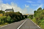 For a short section after Glenbeigh the N70 Ring of Kerry road uses the formation of the Valentia Harbour railway line. The overbridge marks the spot where the former Mountain Stage Station  ...